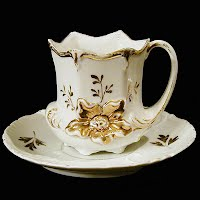 Antique Porcelain White and Gold Cup and Saucer