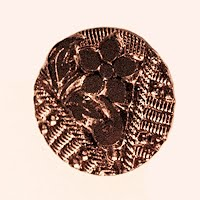 Antique Carved Black and Gold Flower Button