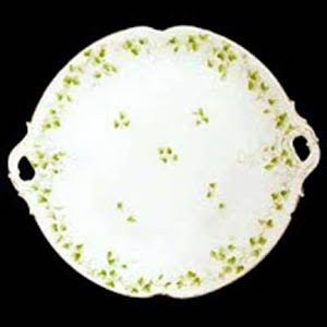 Antique Bread Plate, white with 4 leaf clovers with handles