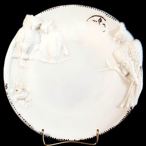 antique plate, milk glass with parrot and bird design