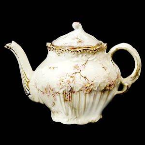Antique porcelain small teapot with floral design