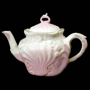 Antique porcelain small teapot with pink luster shell design