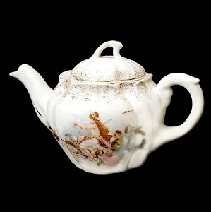 Antique porcelain small teapot with floral design, fairy and bees