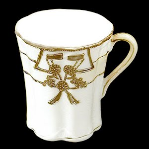 Antique Nippon Porcelain chocolate cup with gold