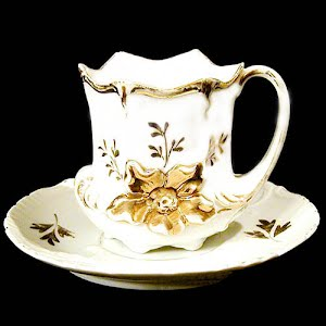 Antique porcelain chocolate mug and saucer white and gold