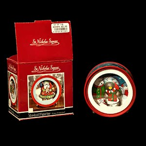 Vintage Christmas Music Box that plays Winter Wonderland with dancing Penguin