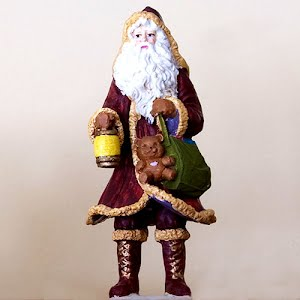 Vintage Santa holding Lantern