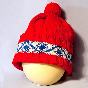 Hand Knitted Navy, White, and Red Stocking Cap with Pom Pom