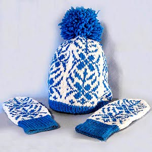 Hand Knitted White and Blue Snowflake Design Stocking Cap with Pom Poms and matching mittens