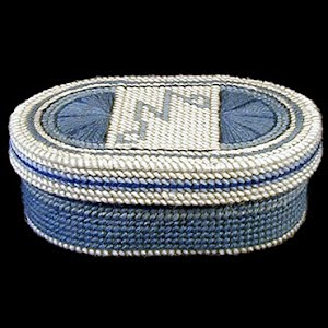 Blue and White oval lined box, yarn on plastic