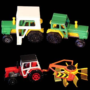 Metal tractors with cab and hay rake toys