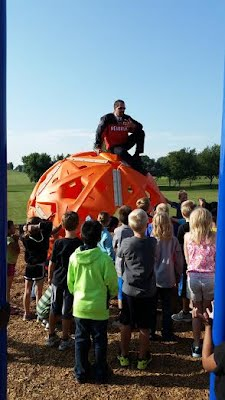 Principal Lentell teaches the 2nd graders about the new playgound!