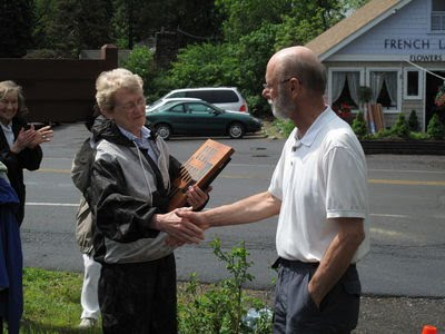 Dianne Conneman, Conservation Board Chair, presents a plaque to Tom Reimers