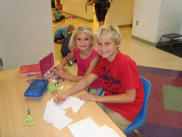 Two elementary students working together