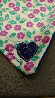 Garment protector with monogram