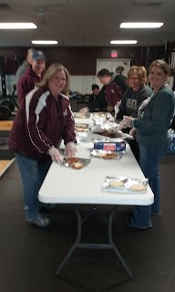 Athletic Booster Club Helping pack food