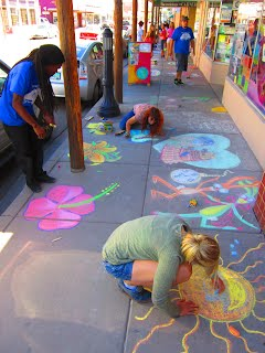 The Wellness Coalition's YVC and Americorps Members add color to otherwise drab, concrete slabs.