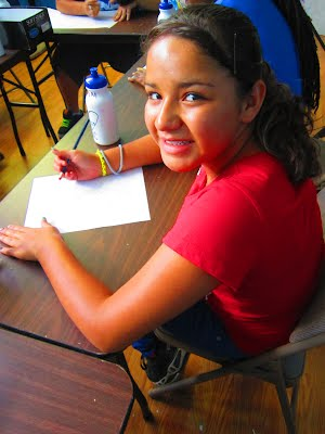 "Kiara Murillo writes a few ideas down during TWC's ""Girls Just Wanna Have Fun"" project."