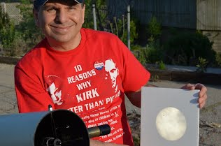Dr. Luzzoi holding a projection of Transit-of-Venus across sun.