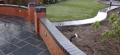 red brick wall with charcoal header cource