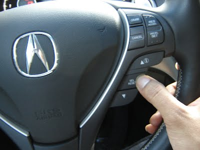 Then select the SEL/RESET button on the Steering Wheel