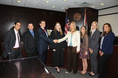 From L to R:  George Melendez, Tyler Nelson, Adam B. Cordover, Judge Laurel Lee, Joryn Jenkins, Pamela Burton, Jennifer Mockler, Monica Ospina