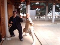 Trey Woodford with monk at South Shaolin Temple in Quanzhou, Fujian,  China