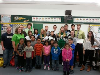 Spanish III High School students reading stories to 3rd, 4th, and 5th grade students