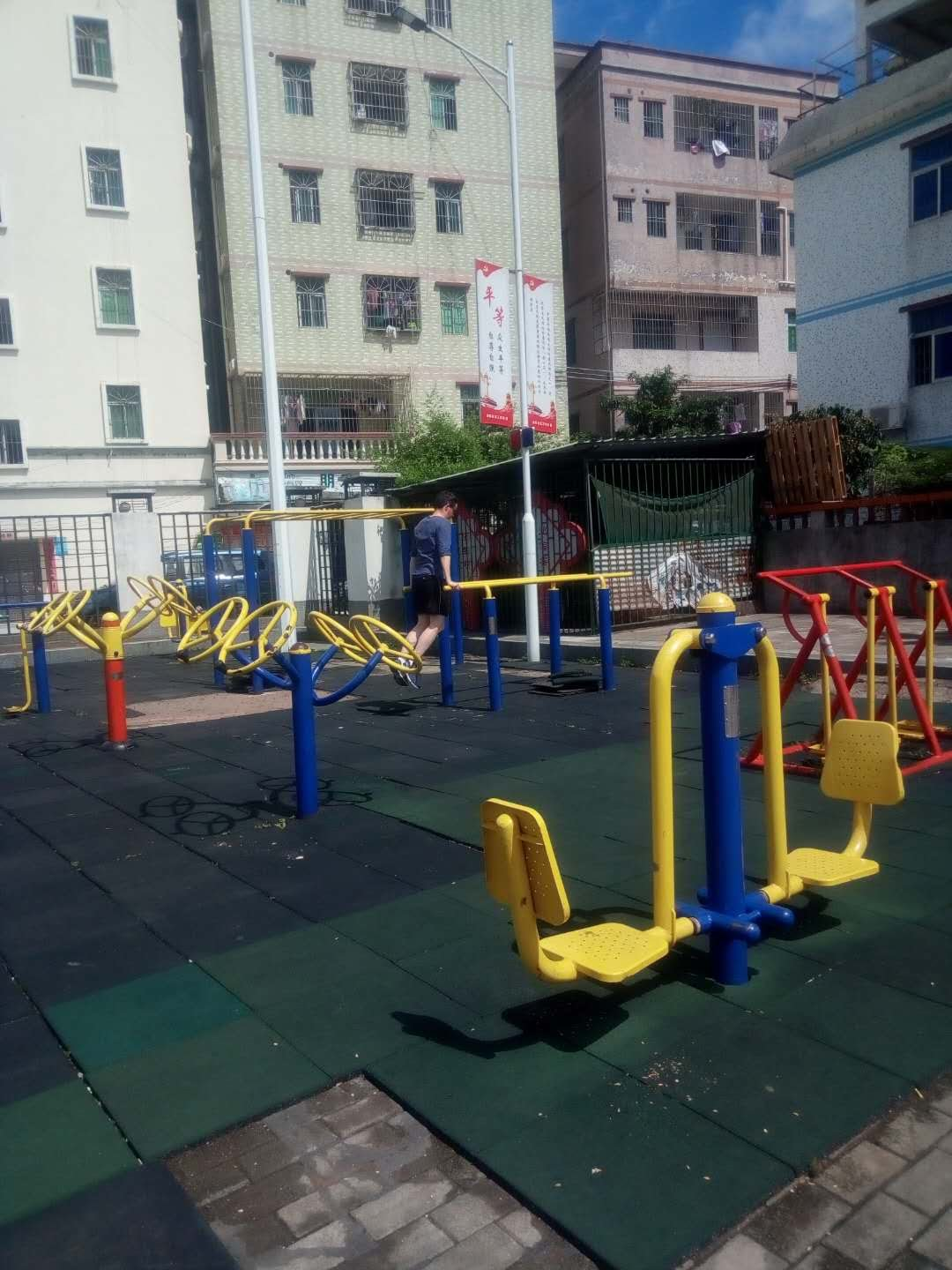 Exercising in an outdoor gym