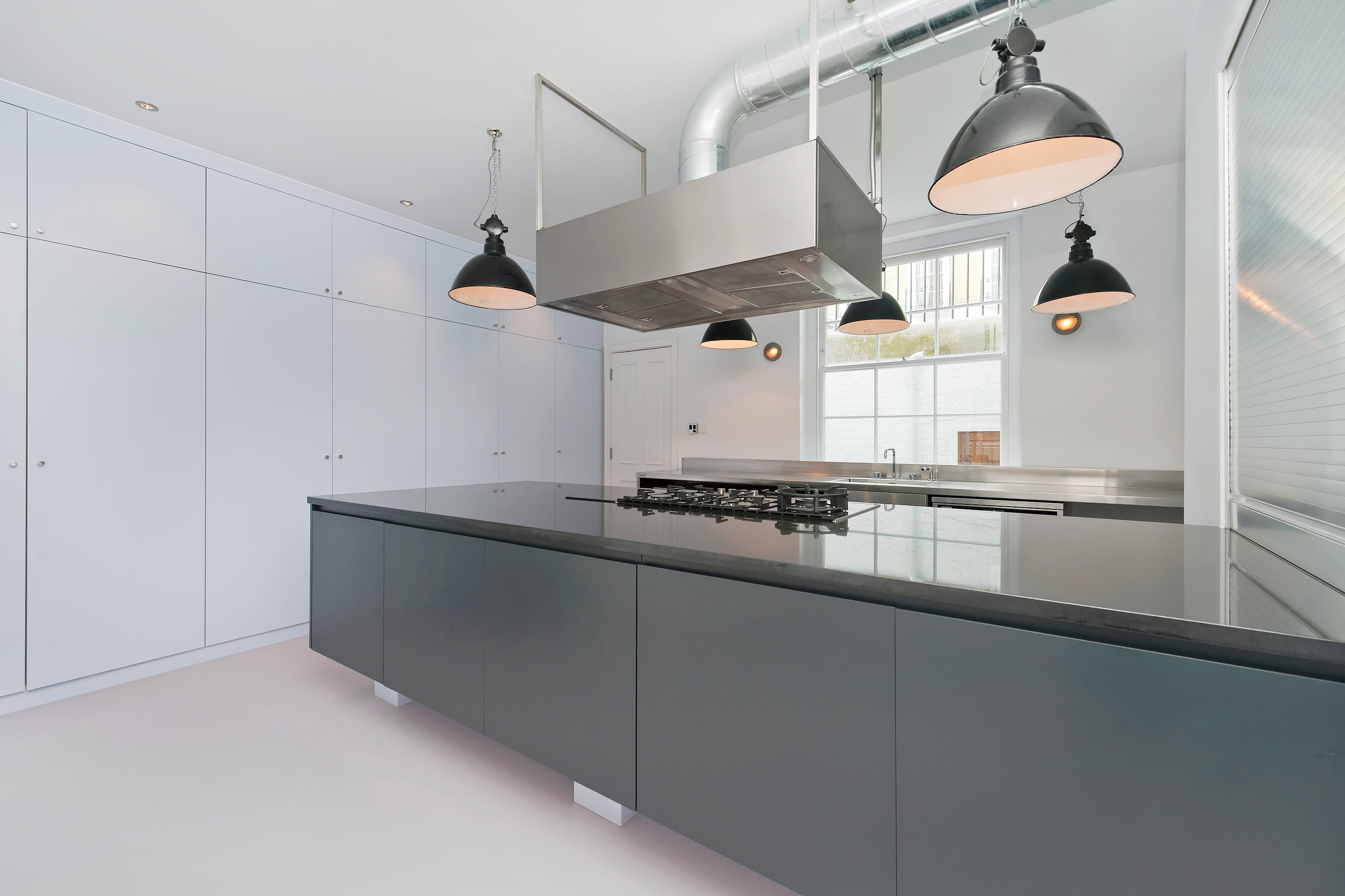 Fresh Large floor to ceiling built in cupboards including larder cupboards drawers on both sides of island aluminium shuttered shelves above island ideal for