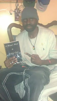 The God Wise Sincere holding a copy of my book A Woman's Worth.