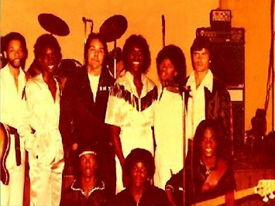 """D.J. Sir T. of (K.C.H.J), 1010, a.m., with DJ Flash of (K.T.K.R), 1350, a.m. and the """"Black Diamond Band,"""" in 1979."""
