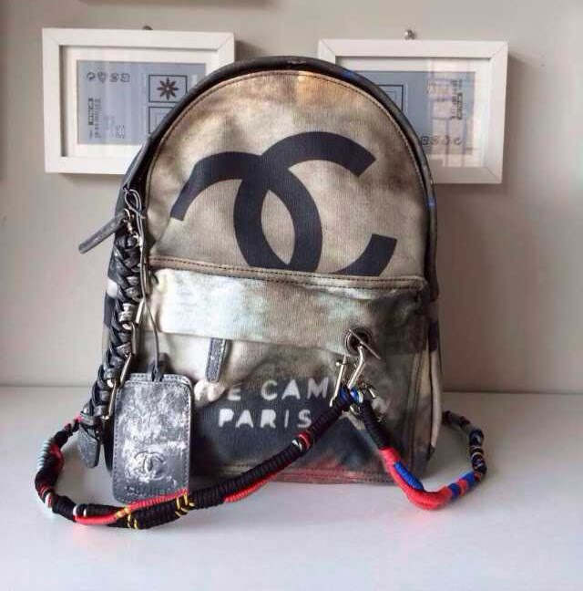 Chanel graffiti printed canvas backpack in black, grey ...