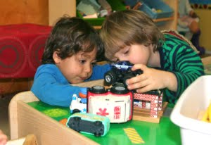coop kids play with trucks