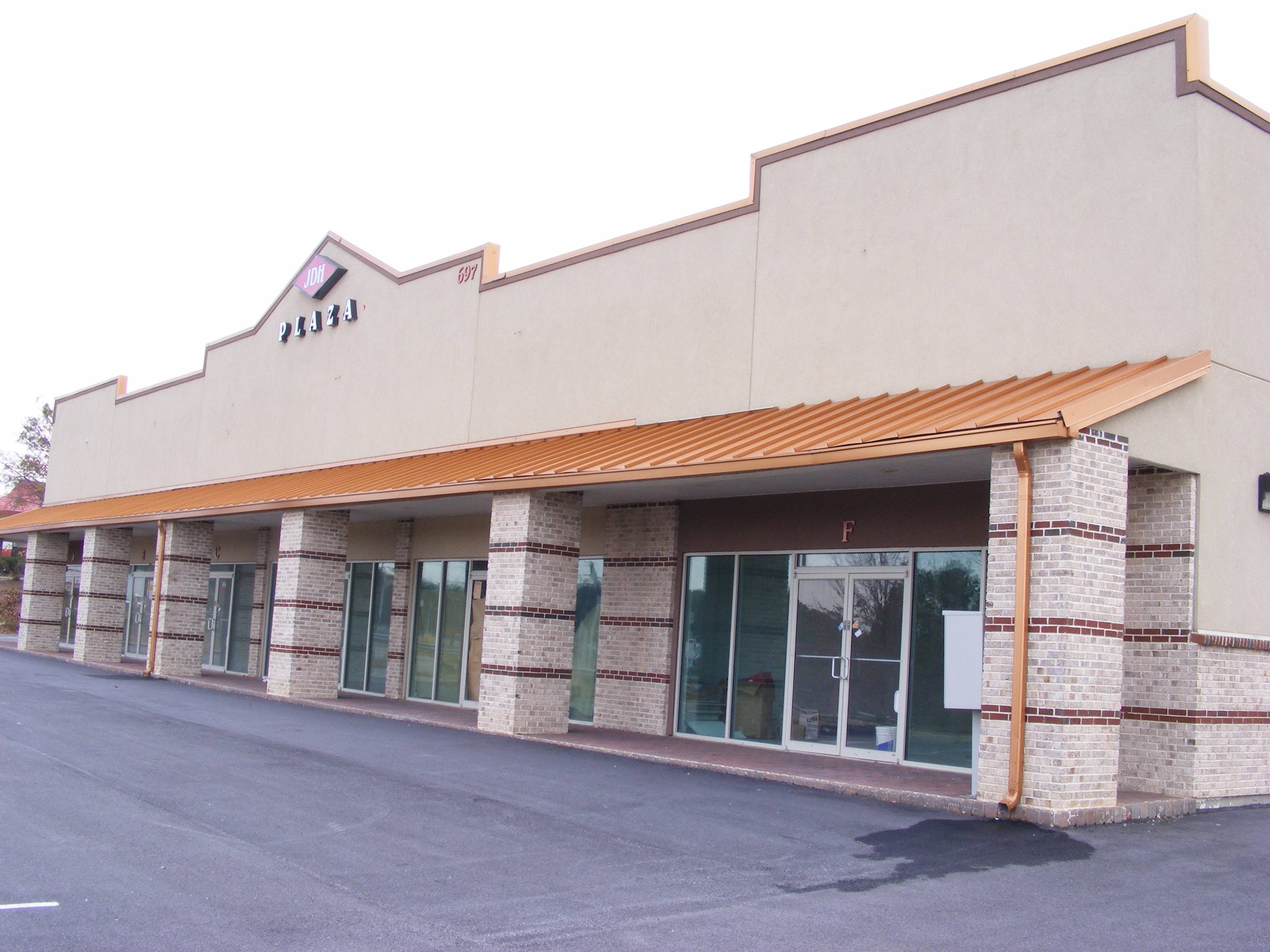 The Building Has Synthetic Stucco With Brick Base And Columns Aluminium Framed Glass Storefronts Strip Center Faces Jonesboro Home Depot