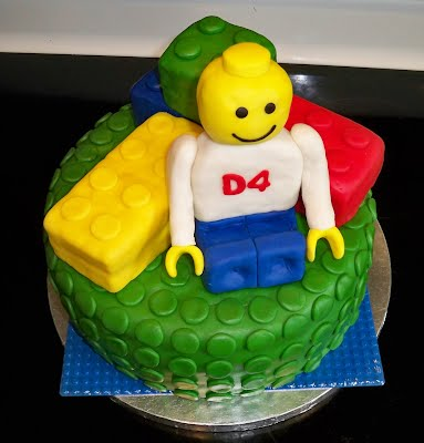 Lego Themed 4th Birthday Cake Fondant Covered Cereal Treat Blocks And Man