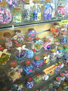 Jars In The Store Filled With Paper Stars