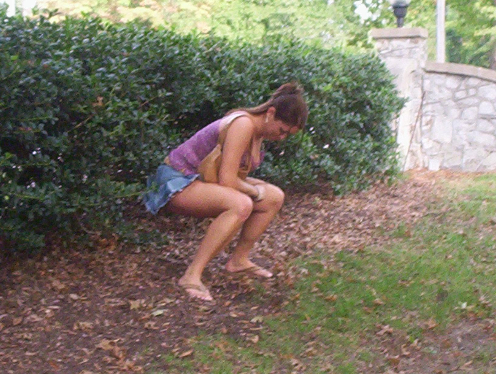 Girl peeing in the woods