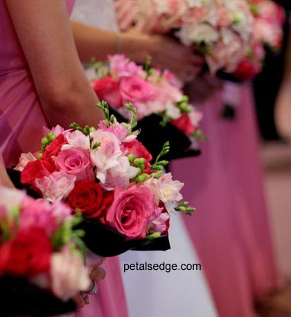 Bride: Hand-tied bouquet of open hot pink roses, open esperance roses,