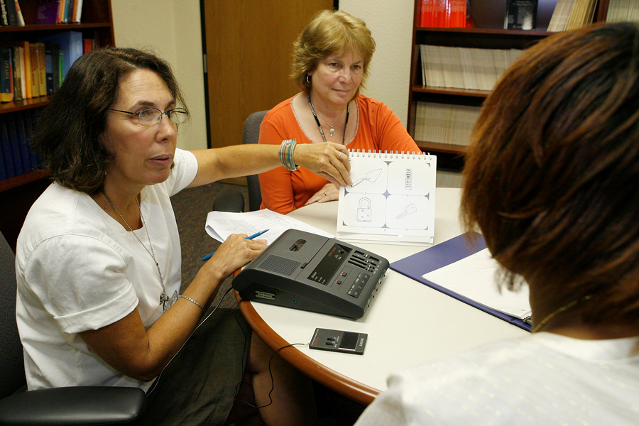 Dr. Nadine Martin observes as Research Speech-Language Pathologist Francine Kohen tests a stroke patient's vocabulary comprehension. Photographed by Joseph V. Labolito/Temple University  Photography.  Photograph and caption Re-printed with permission of Temple Times