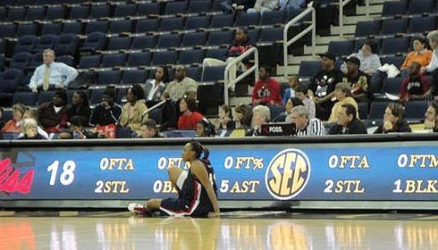 Ole Miss player waits at scorer's table to enter game