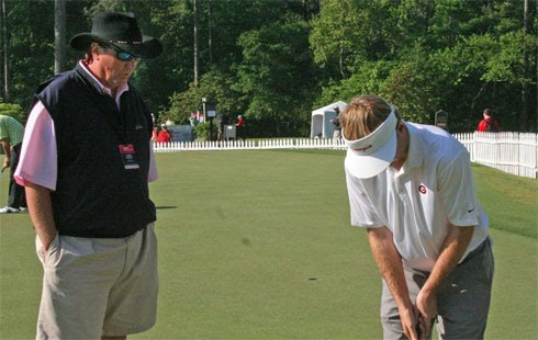 University of Georgia Coach/SEC Coach of the Year Chris Haack offers quiet advice to UGA Golfer/SEC Golfer of the Year Russell Henley on the putting green before the second round of  the Nationwide Tour's Stadion Athens Classic at UGA