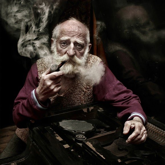 digital photograph of man with mustache and beard smoking pipe