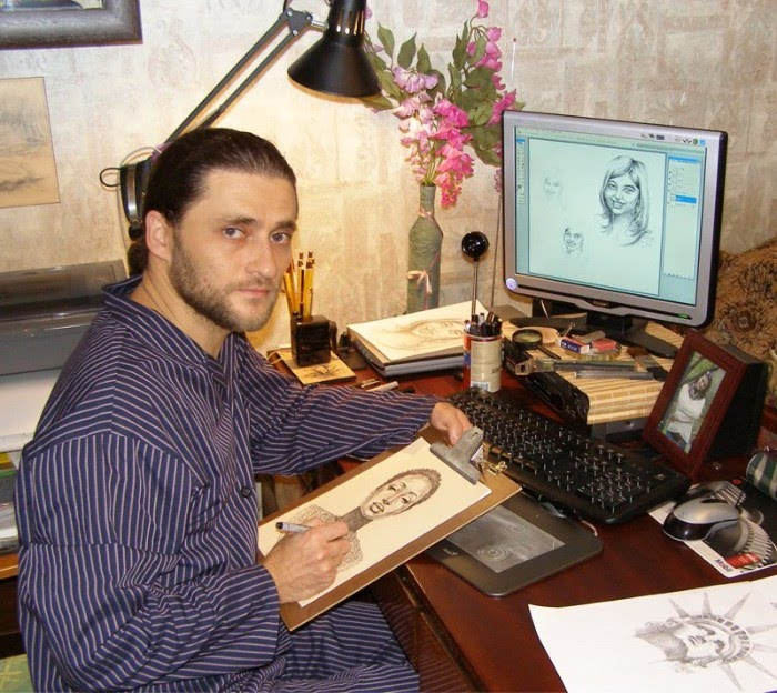 photograph of artist igor lukyanov at work with a new drawing
