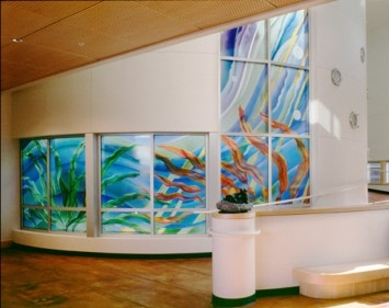 architectural glass window in the main lobby and adjacent cylindrically-shaped  aquatic therapy center of Mott Children's Center