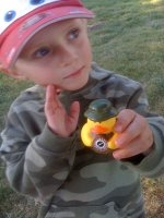 Cameron shows off his geocacher duck.