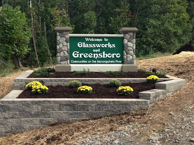 The new sign welcoming people to Glassworks and Greensboro was sponsored by the Elm Street Project, and designed through the Image and Identity Team, Brenda Martin, Team Leader.  Many volunteer hours for landscaping the sign were provided by the Elm Street Clean Safe and Green Team, Olivia Burich Team Leader.  Thank you to all the volunteers, and the Nathanael Greene Historical Foundations for additional donations for making our new sign beautiful.