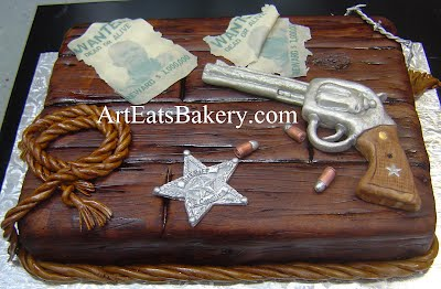 Unique custom edible wood men's birthday cake design with edible wanted poster, gun, rope, bullets, sheriff's badge and barbed wire