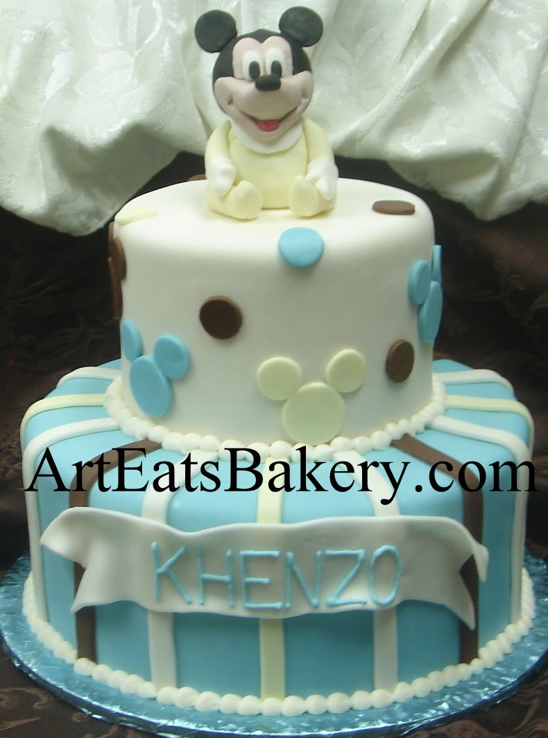 Baby Mickey Mouse two tier blue, brown and yellow fondant custom creative baby boy shower cake design idea with edible Mickey