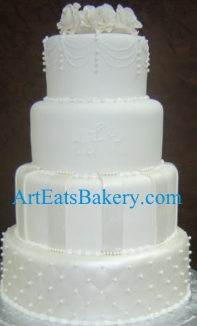Four tier white fondant custom modern pearl, stripes and diamond quilt wedding cake design with edible rose topper